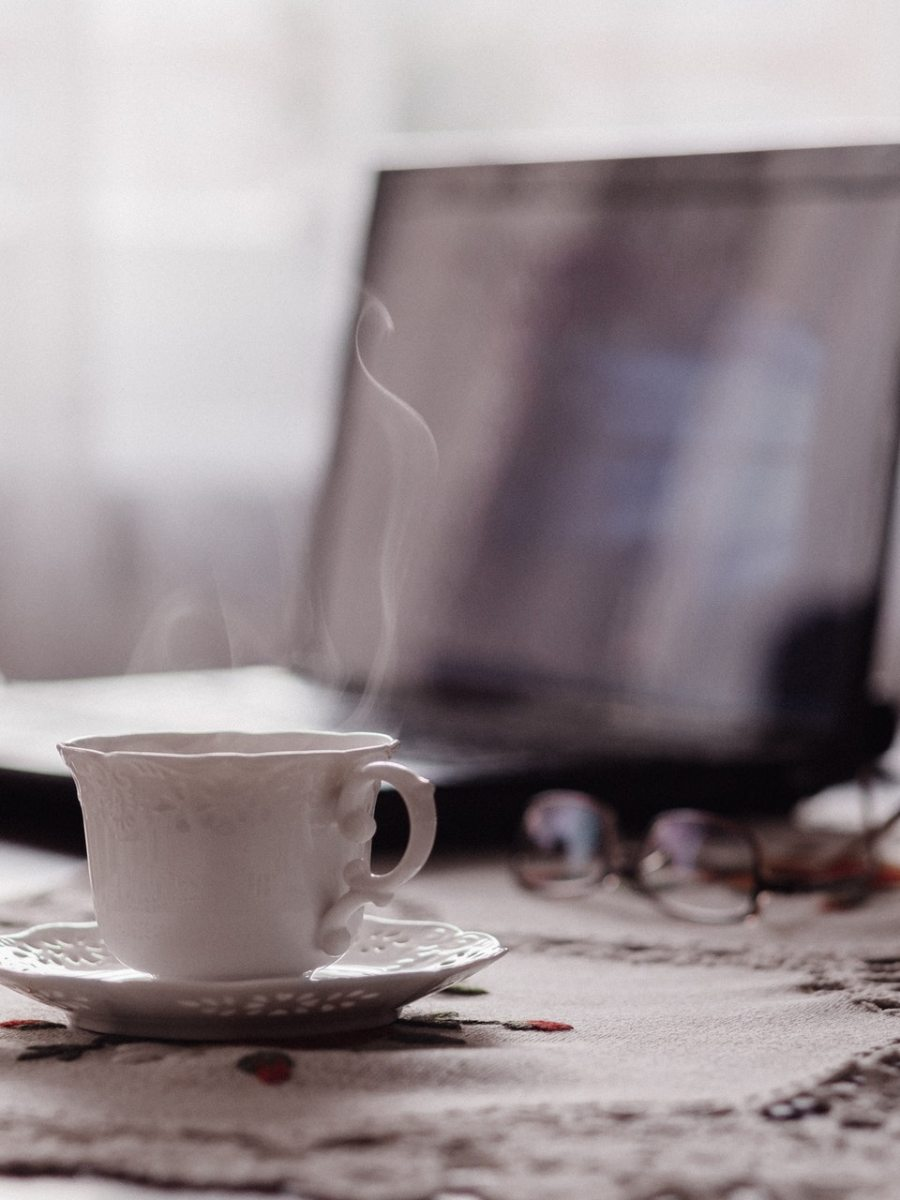 laptop with cup of tea